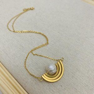 Tory Burch Spinning Mother of Pear Necklace